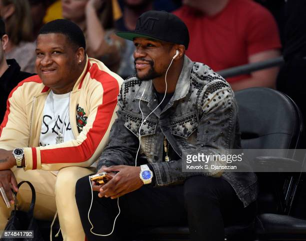 Boxer Floyd Mayweather Jr attends the basketball game between Philadelphia 76ers and Los Angeles Lakers at Staples Center November 15 in Los Angeles...