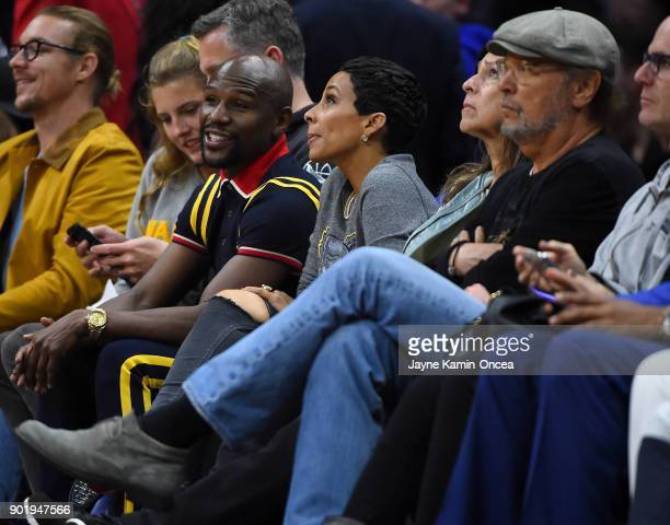 Boxer Floyd Mayweather Jr attends the game between the Los Angeles Clippers and the Golden State Warriors on January 6 2018 in Los Angeles California...