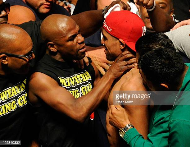 Boxer Floyd Mayweather Jr grabs the neck of Victor Ortiz after the weighin for their WBC welterweight title fight at the MGM Grand Garden Arena on...