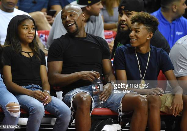 Boxer Floyd Mayweather Jr his daughter Jirah Mayweather and his son Koraun Mayweather attend a 2017 Summer League game between the Boston Celtics and...