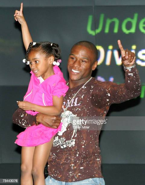 Boxer Floyd Mayweather Jr holds his daughter Iyanna Mayweather during a news conference at the MGM Grand Hotel/Casino as part of a media tour...