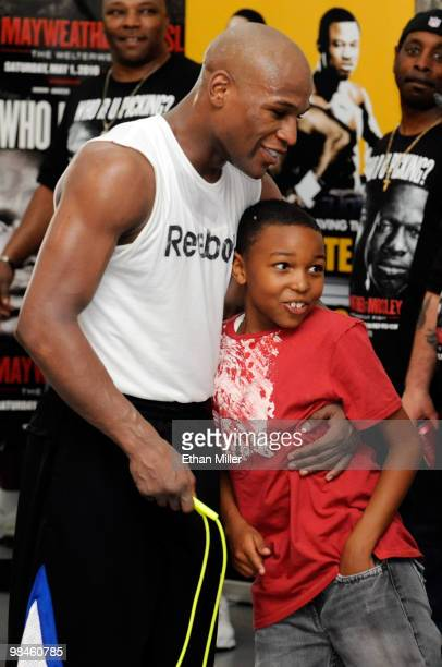 Boxer Floyd Mayweather Jr hugs his son Koraun Mayweather during a workout April 14 2010 in Las Vegas Nevada Mayweather is scheduled to face Shane...