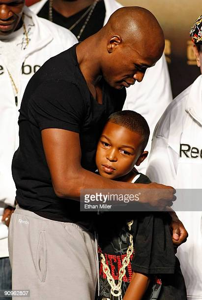 Boxer Floyd Mayweather Jr hugs his son Koraun Mayweather during the official weighin for his fight against Juan Manuel Marquez at the MGM Grand...