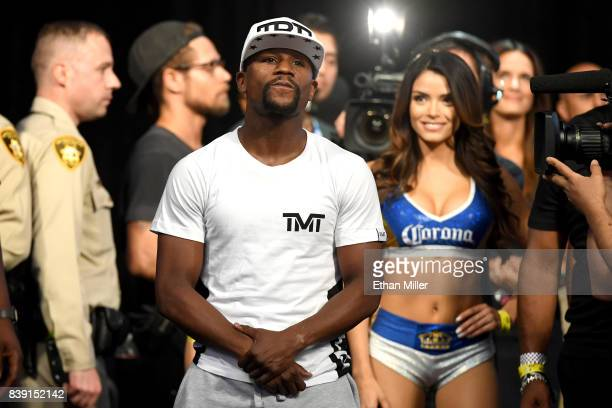 Boxer Floyd Mayweather Jr looks on after his face off with UFC lightweight champion Conor McGregor during their official weighin at TMobile Arena on...