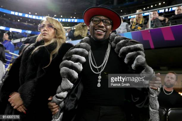 Boxer Floyd Mayweather Jr. Looks on during Super Bowl LII between the New England Patriots and the Philadelphia Eagles at U.S. Bank Stadium on...