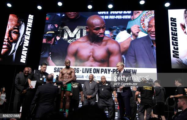 Boxer Floyd Mayweather Jr poses during a weighin with MMA figher Connor McGregor August 25 2017 at the TMobile Arena in Las Vegas Nevada Mayweather...
