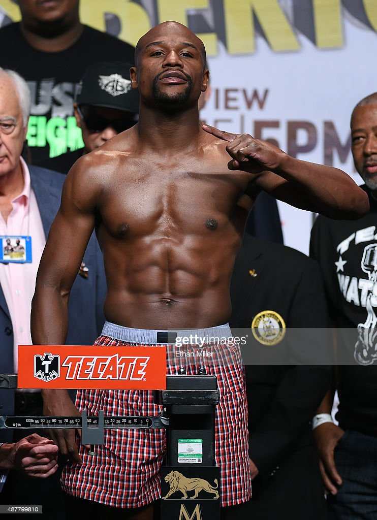 Boxer Floyd Mayweather Jr. poses on the scale during his official weigh-in at MGM Grand Garden Arena on September 11, 2015 in Las Vegas, Nevada. Mayweather will defend his WBC/WBA welterweight titles against Andre Berto on September 12 at MGM Grand in Las Vegas.