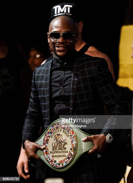 Boxer Floyd Mayweather Jr poses with the Money Belt during a news conference at the KA Theatre at MGM Grand Hotel Casino on August 23 2017 in Las...