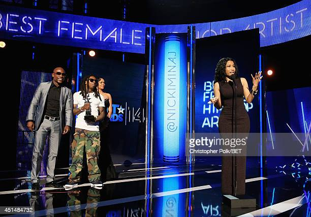 Boxer Floyd Mayweather Jr rapper Lil Wayne and singer Nicki Minaj onstage during the BET AWARDS '14 at Nokia Theatre LA LIVE on June 29 2014 in Los...