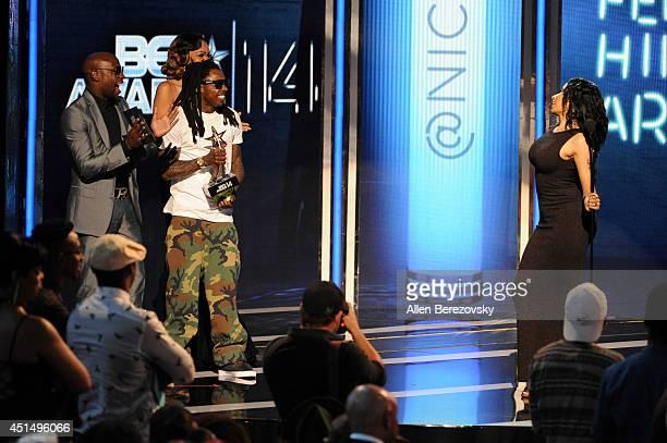 Boxer Floyd Mayweather Jr rapper Lil Wayne and singer Nicki Minaj onstage during the BET Awards '14 at Nokia Theatre LA Live on June 29 2014 in Los...