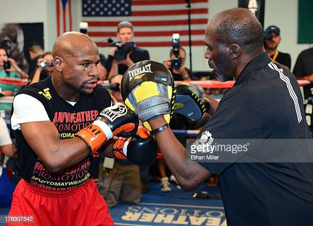 Boxer Floyd Mayweather Jr works out with his trainer and uncle Roger Mayweather at the Mayweather Boxing Club on August 28 2013 in Las Vegas Nevada...