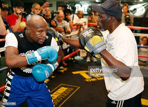 Boxer Floyd Mayweather Jr works out with his trainer and uncle Roger Mayweather at the Mayweather Boxing Club on September 2 2014 in Las Vegas Nevada...