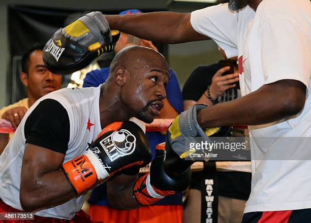 Boxer Floyd Mayweather Jr works out with his trainer and uncle Roger Mayweather at the Mayweather Boxing Club on April 22 2014 in Las Vegas Nevada...