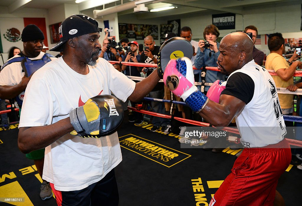 Boxer Floyd Mayweather Jr. (R) works out with his trainer and uncle Roger Mayweather at the Mayweather Boxing Club on April 22, 2014 in Las Vegas, Nevada. Mayweather Jr. will face Marcos Maidana in a 12-round world championship unification bout in Las Vegas on May 3.