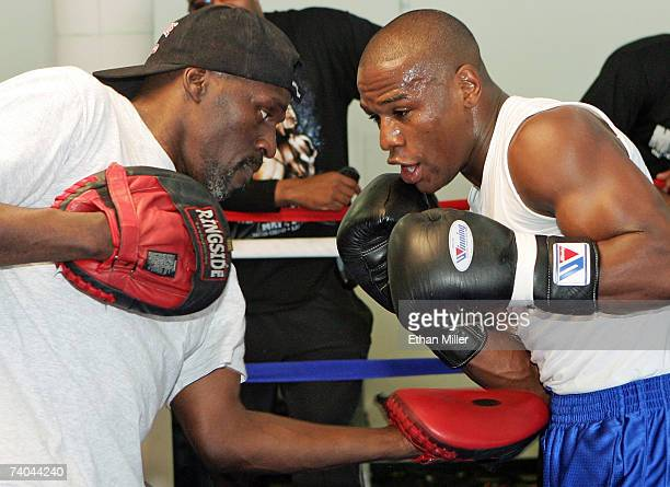 Boxer Floyd Mayweather Jr works out with his trainer and uncle Roger Mayweather at the Mayweather Boxing Club May 1 2007 in Las Vegas Nevada...