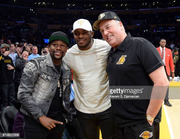 Boxer Floyd Mayweather Jr Yasiel Puig of the Los Angeles Dodgers and Irv Bauman pose for a photograph as they attend the basketball game between...