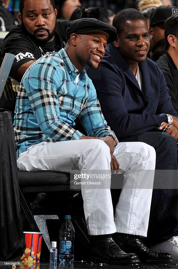 Boxer, Floyd Mayweather watches the game between the Los Angeles Lakers and the Sacramento Kings at the MGM Grand Garden Arena on October 10, 2013 in Las Vegas, Nevada.