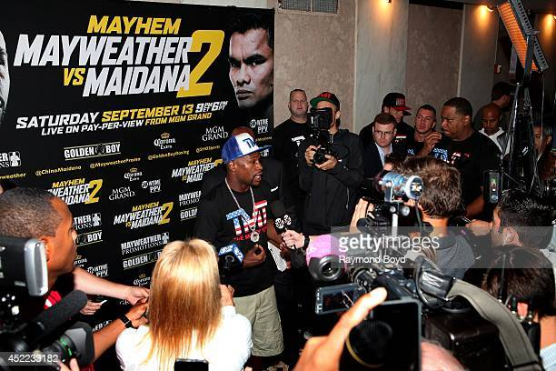 Boxer Floyd 'Money' Mayweather Jr is interviewed during the 'Mayhem Mayweather vs Maidana II' championship rematch press conference at the Congress...