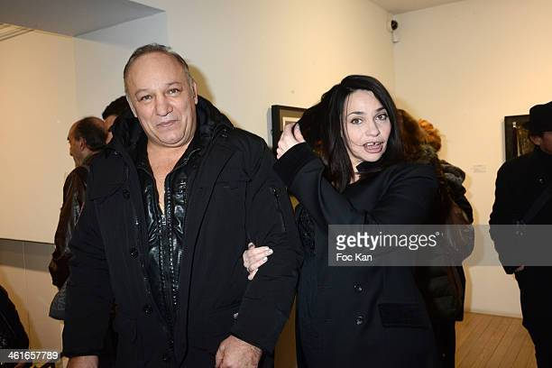 Boxer Franck Tiozzo and Beatrice Dalle attend the 'Bande A Part' Richard Aujard Photo Exhibition Preview At Galerie Laurent Strouk on January 9 2014...