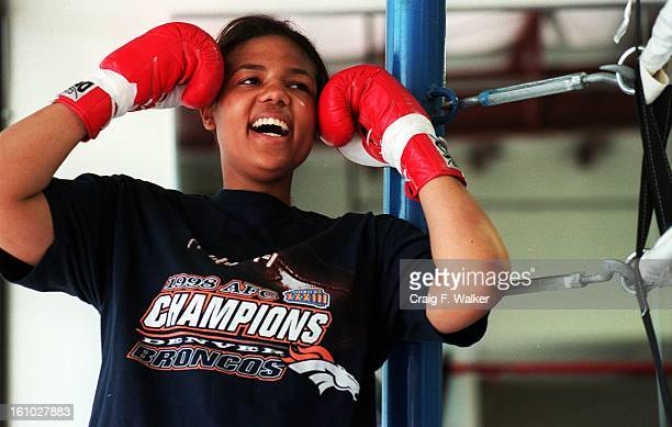 Boxer Freeda Foreman daughter of former heaveyweight champion George Foreman jokes with her trainer while posing for a portrait at America Presents...