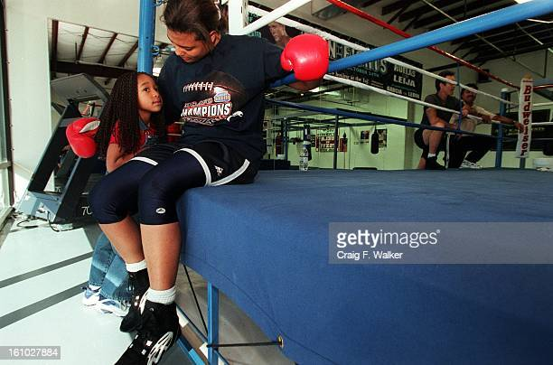 Boxer Freeda Foreman daughter of former heaveyweight champion George Foreman relaxes with her daughter Justice Carr after working out at America...