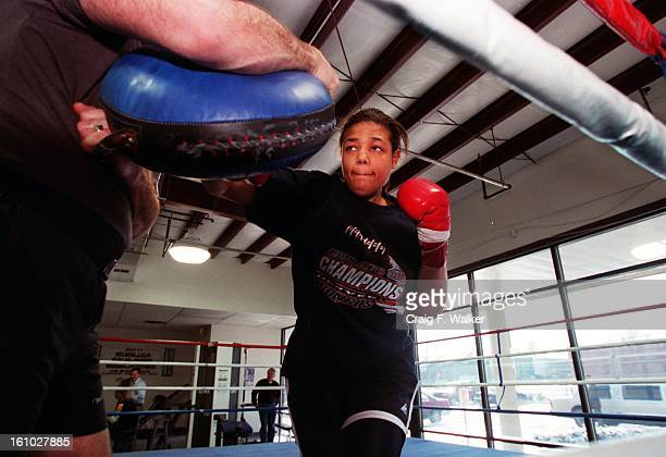 Boxer Freeda Foreman daughter of former heaveyweight champion George Foreman works out with her trainer Larry Goossen at America Presents Gym in...