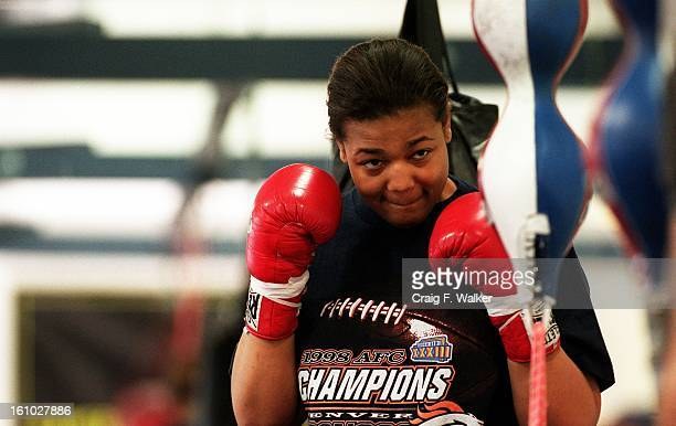 Boxer Freeda Foreman daughter of former heaveyweight champion George Foreman warms up during a training session at America Presents Gym in Denver
