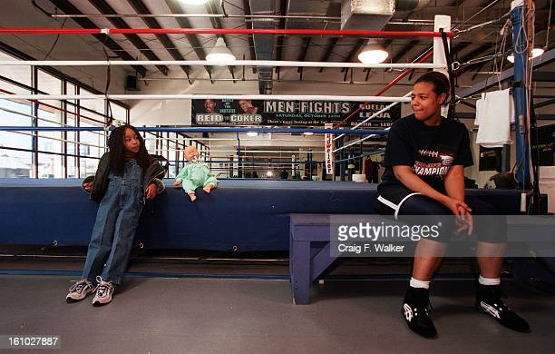 Boxer Freeda Foreman daughter of former heaveyweight champion George Foreman relaxes with her daughter Justice Carr before working out at America...