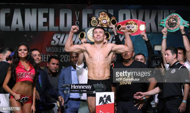 Boxer Gennady Golovkin poses on the scales during a weighin with Canelo Alvarez at the MGM Grand Hotel Casino on September 15 2017 in Las Vegas...