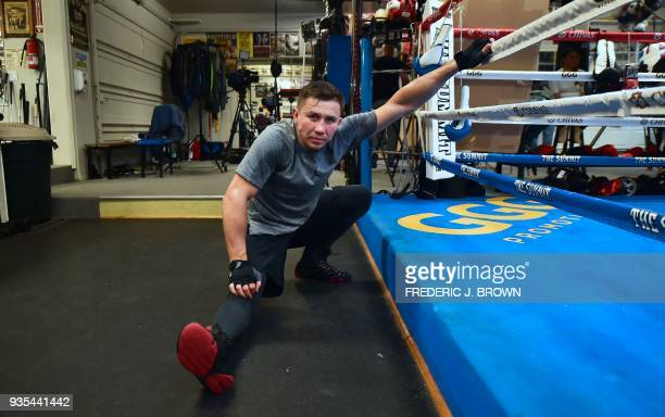Boxer Gennady Golovkin stretches ringside during a media workout on March 20 2018 in Big Bear California ahead of his fight against Canelo Alvarez in...