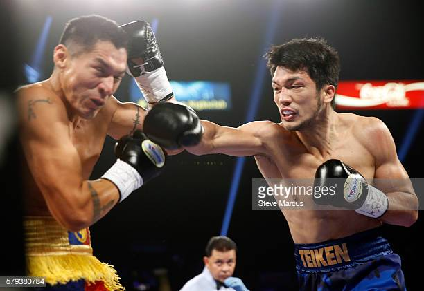 Boxer George Tahdooahnippah takes a punch from Ryota Murata of Japan during their middleweight fight at MGM Grand Garden Arena on July 23 2016 in Las...