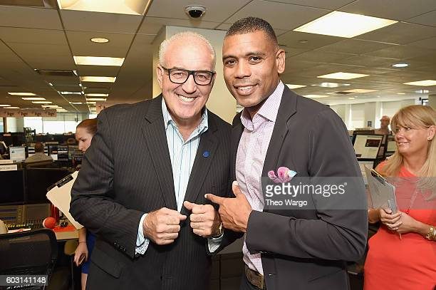 Boxer Gerry Cooney NBA player Allan Houston attend Annual Charity Day hosted by Cantor Fitzgerald BGC and GFI at BGC Partners INC on September 12...