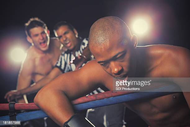 boxer giving up in boxing match after losing to competitor - knockout stock pictures, royalty-free photos & images