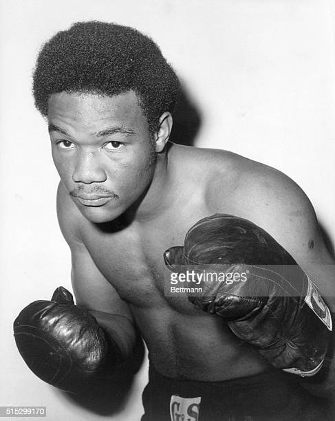 Boxer Goerge Foreman is shown in a typical waist up boxing pose. Undated.