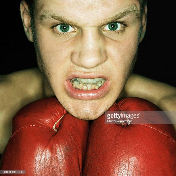 Boxer gritting teeth, portrait, close-up