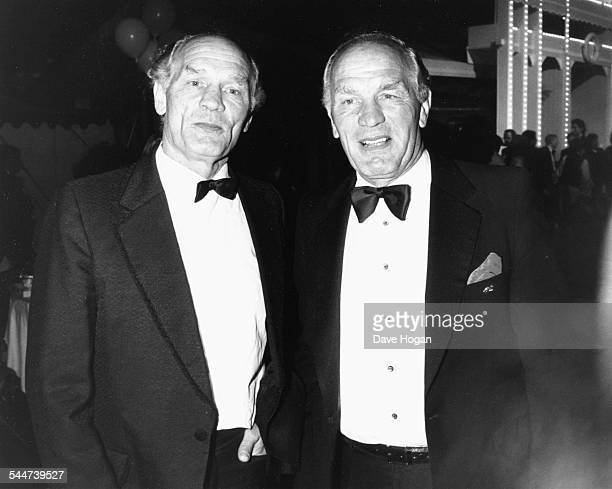 Boxer Henry Cooper and his twin brother attending the Berkley Square Ball London July 4th 1988