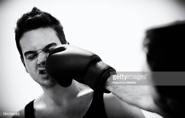 boxer hit hard during a match - punching stock pictures, royalty-free photos & images