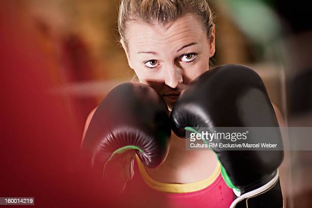 Boxer holding up fists in gym