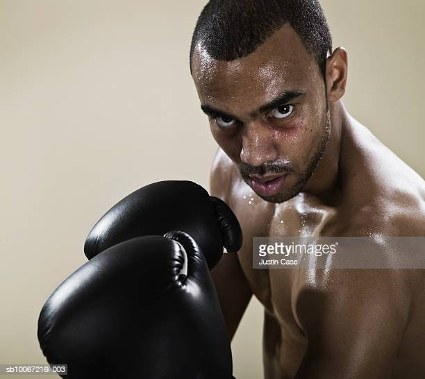Boxer in fighting stance, portrait, close-up