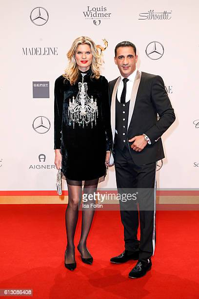 Boxer Ismail Oezen and Janina Otto attend the Tribute To Bambi at Station on October 6 2016 in Berlin Germany