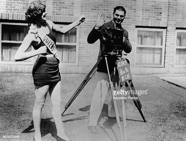 Boxer Jack Dempsey as a photographer with a beauty queen on October 9 1924 in New York NY