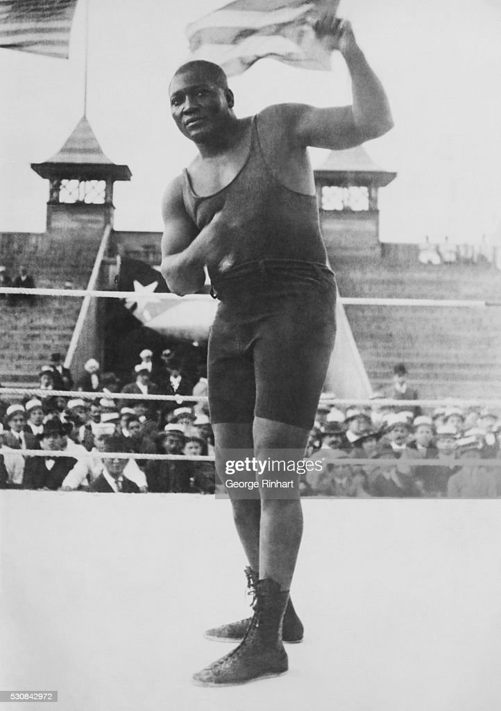 Boxer Jack Johnson, in boxing ring.