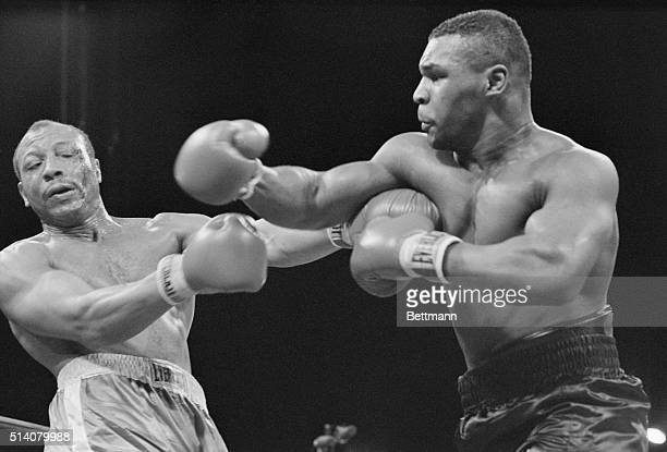 Boxer James 'Bonecrusher' Smith reels from the force of a right from Mike Tyson in a heavyweight title fight in Las Vegas Nevada March 7 1987