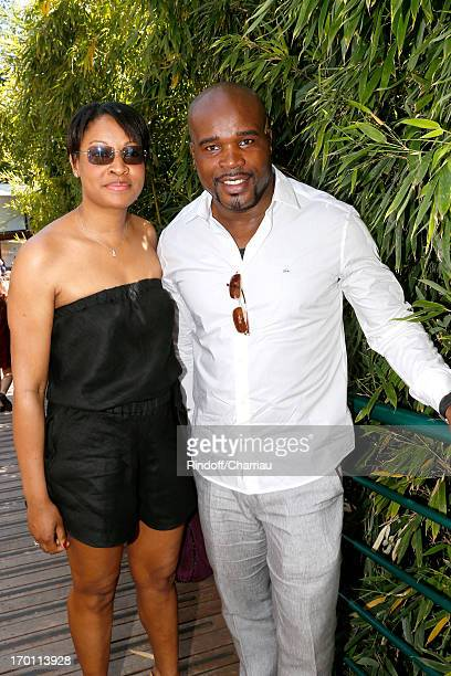 Boxer JeanMarc Mormeck and his companion Sandra sighting at Roland Garros Tennis French Open 2013 Day 13 on June 7 2013 in Paris France