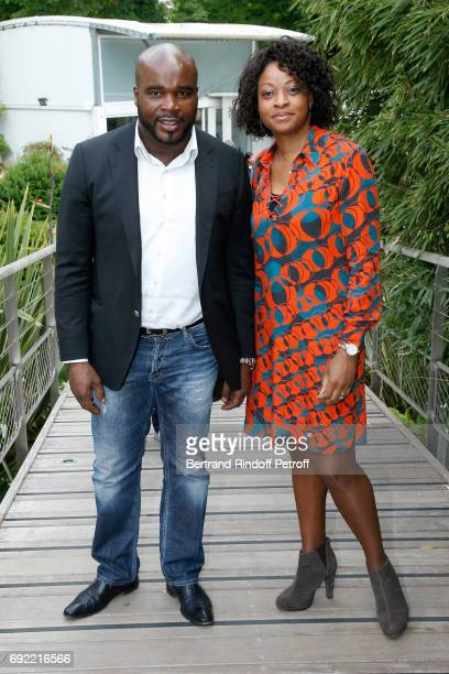 Boxer JeanMarc Mormeck and his wife Sandra attend the 2017 French Tennis Open Day Height at Roland Garros on June 4 2017 in Paris France