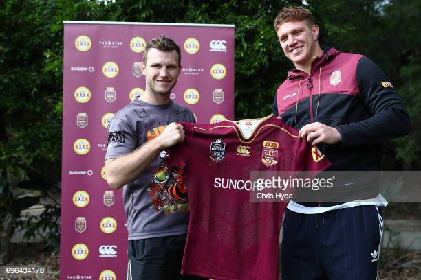Boxer Jeff Horn is presented with a Maroons jersey from Dylan Napa during a visit to the Queensland Maroons State of Origin team during a training...