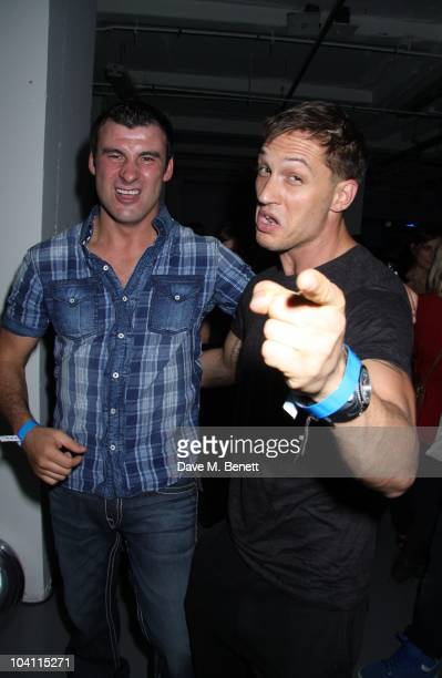 Boxer Joe Calzaghe and actor Tom Hardy attend the XBox 360 Halo Reach launch party at Victoria House on September 9 2010 in LondonEngland