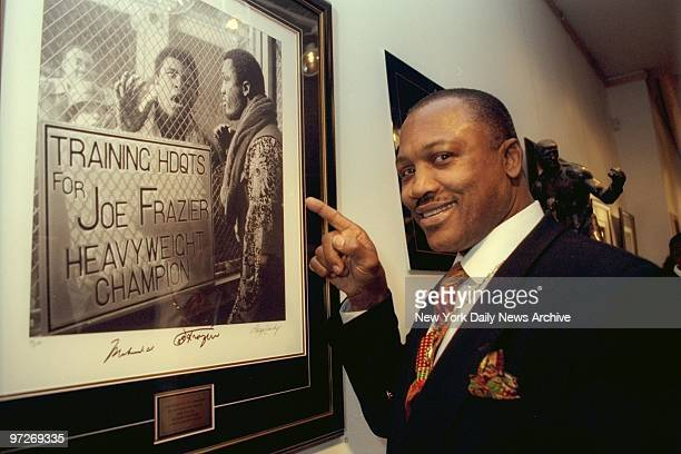 Boxer Joe Frazier attending George Kalinsky's Fight of the Century sports photography exhibit at Axelle Fine Arts Gallery in Soho