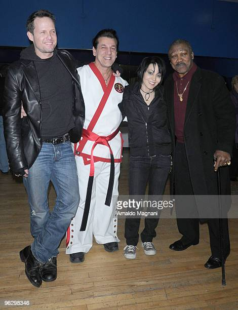 Boxer Joe Frazier boxer actor Chuck Zito actor Dean Winters and musician Joan Jett appear together at Street Survival School of martial arts at the...