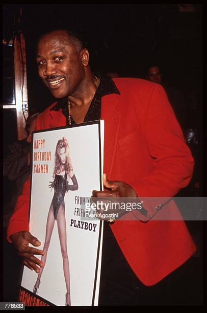 Boxer Joe Frazier holds a pictorial of Carmen Electra April 19, 1996 in New York City. Carmen Electra had a party thrown in her honor by Playboy...